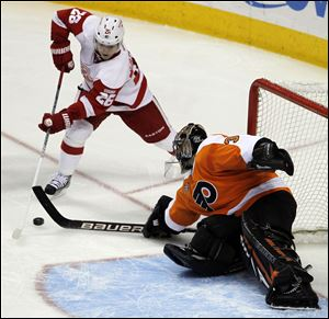 Philadelphia Flyers goalie Ilya Bryzgalov (30), from Russia, blocks a shot by Detroit Red Wings left wing Jiri Hudler (26), from the Czech Repbulic, in the third period of an NHL hockey game Tuesday in Philadelphia. The Flyers won 3-2.