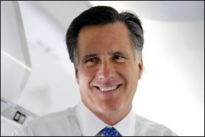 Republican presidential candidate, former Massachusetts Gov. Mitt Romney talks to reporters on his campaign plane before taking off for Boston.