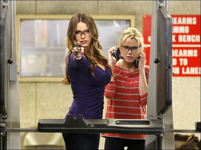Sofia Vergara, left, and Julie Bowen  Sofia Vergara, left, and Julie Bowen are shown in a scene from a an episode of 'Modern Family.' Vergara plays Gloria Pritchett, who is stepmother to Bowen's Claire Dunphy.