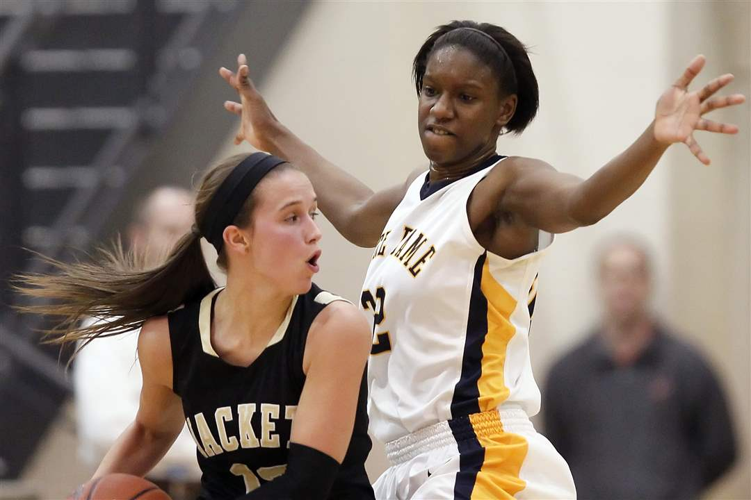 Notre-Dame-s-Michelle-Holmes-32-defends-against-Perrysburg-s-Taylor-Knight