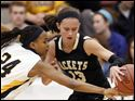 Notre Dame's Cat Wells (24) steals the ball from Perrysburg's Taylor Knight (13) Tuesday, 03/06/12, during a Division I girls regional semifinal at Central Catholic High School in Toledo, Ohio. Notre Dame won.