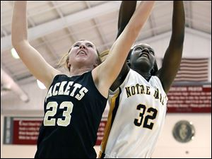 Notre Dame's Michelle Holmes (32) and  Perrysburg's Sarah Baer (23) battle for a rebound Tuesday, 03/06/12, during a Division I girls regional semifinal at Central Catholic High School in Toledo, Ohio. Notre Dame won.