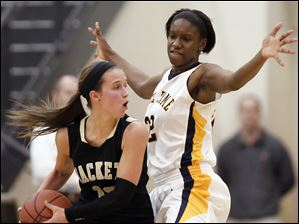 Notre Dame's Michelle Holmes (32) defends against  Perrysburg's Taylor Knight (13) Tuesday, 03/06/12, during a Division I girls regional semifinal at Central Catholic High School in Toledo, Ohio. Notre Dame won.