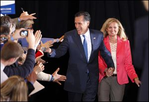 Former Massachusetts Gov. Mitt Romney and his wife, Ann, greet supporters as they arrive at their Super Tuesday rally in Boston. Mr. Romney placed first in the GOP primary in the critical battleground state of Ohio.