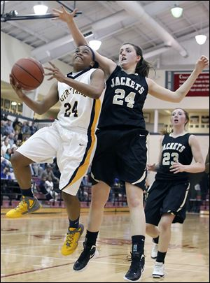 Notre Dame's Michelle Holmes (32) defends against Perrysburg's Taylor Knight (13) Tuesday during a D-I girls regional semifinal.