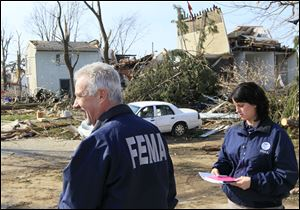 FEMA officials inspect tornado damage in Moscow, Ohio, which was mostly destroyed. Gov. John Kasich activated two disaster-relief programs Tuesday to aid Clermont County communities.