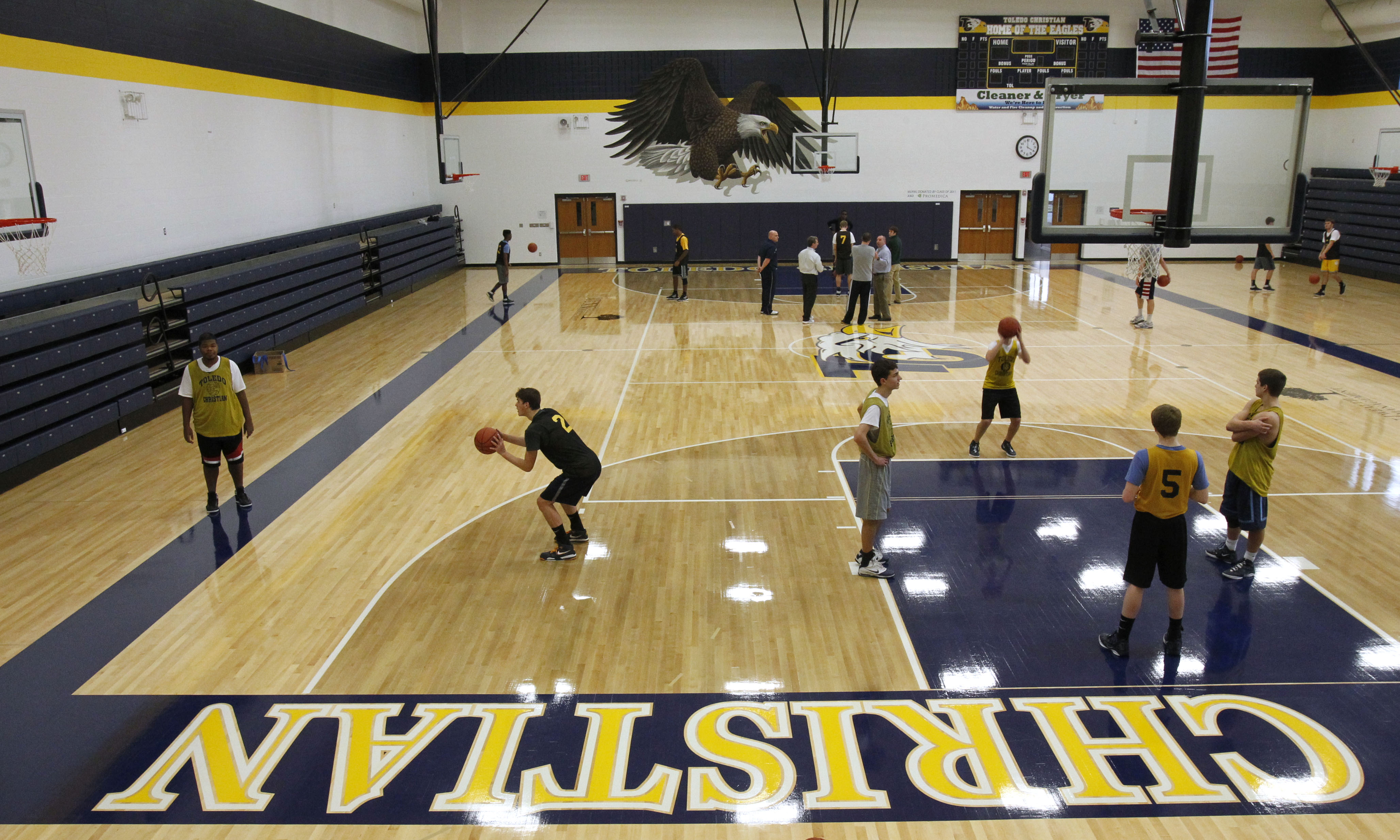 New gym spurs toledo christian the blade for Cost to build a basketball gym