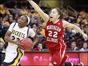 University of Toledo Rocket's Andola Dortch takes the ball to the hoop against Northern Illinois' Amanda Carrol.