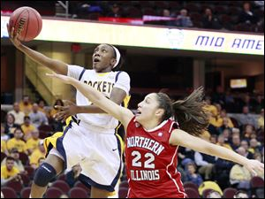 University of Toledo Rocket's Andola Dortch takes the ball to the hoop against Northern Illinois' Amanda Carrol during the women's basketball game at Quicken Loans Arena Thursday.