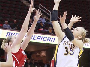 Toledo's Haylie Linn gets the ball to the hoop against Northern Illinois during women's basketball action during the MAC tournament.