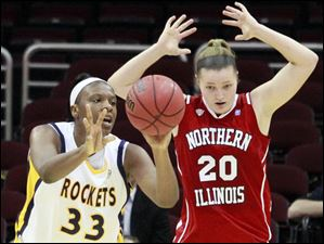 University of Toledo Rockets' Yolanda Richardson grabs the ball before Northern Illinois' Jenna Thorp.