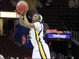 University of Toledo Rockets Andola Dortch hits a three-pointer against Northern Illinois.
