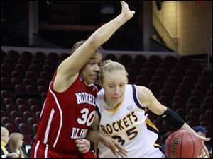 Rockets' Haylie Linn dribbles around Northern Illinois' Alicia Johnson.