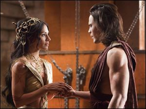 Lynn Collins portrays Dejah Thoris, left, and Taylor Kitsch portrays John Carter in a scene from the new Disney film.