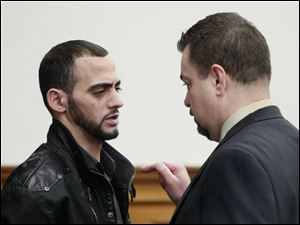 Bandar Abu-Karsh, left, confers with defense attorney John McMahon after his arraignment on an voluntary manslaughter charge.