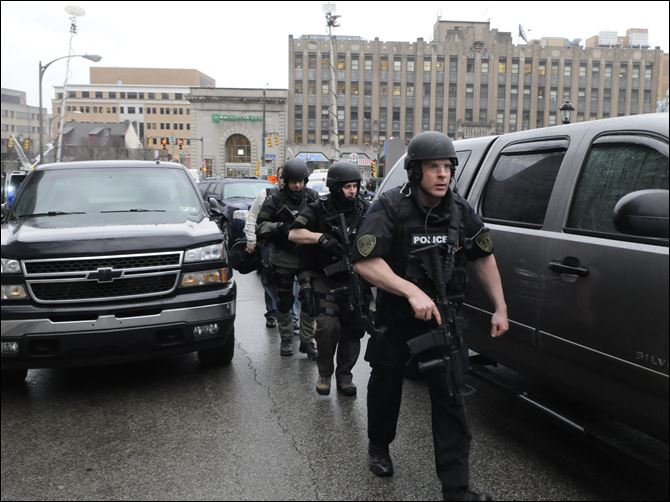 Pittsburgh  police officers Police officers dressed in swat gear make their way towards Western Psychiatric hospital in Pittsburgh.