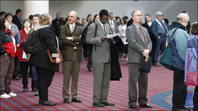 Unemployment Benefits Job seekers stand line during a Career Expo job fair in Portland, Ore.