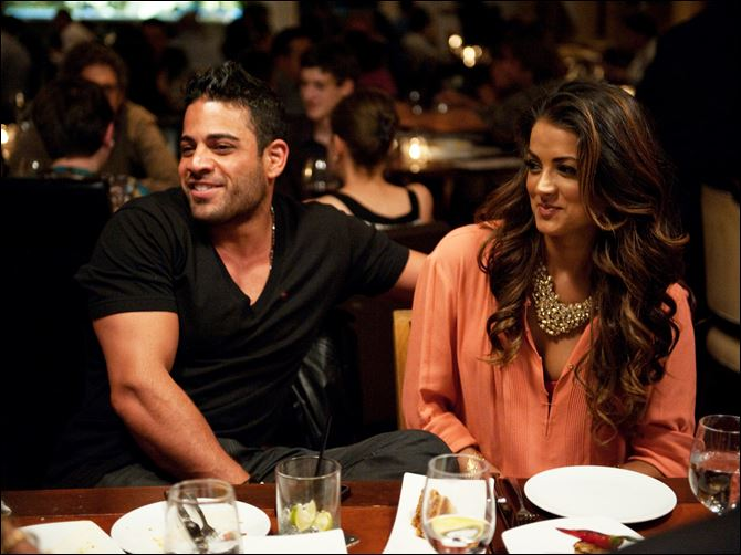 "Mike Shouhed, left, and Golnesa ""GG"" Gharachedagi are shown in a scene from the new series, ""Shahs of Sunset,"" premiering March 11, 2012, at 10 p.m. on Bravo."
