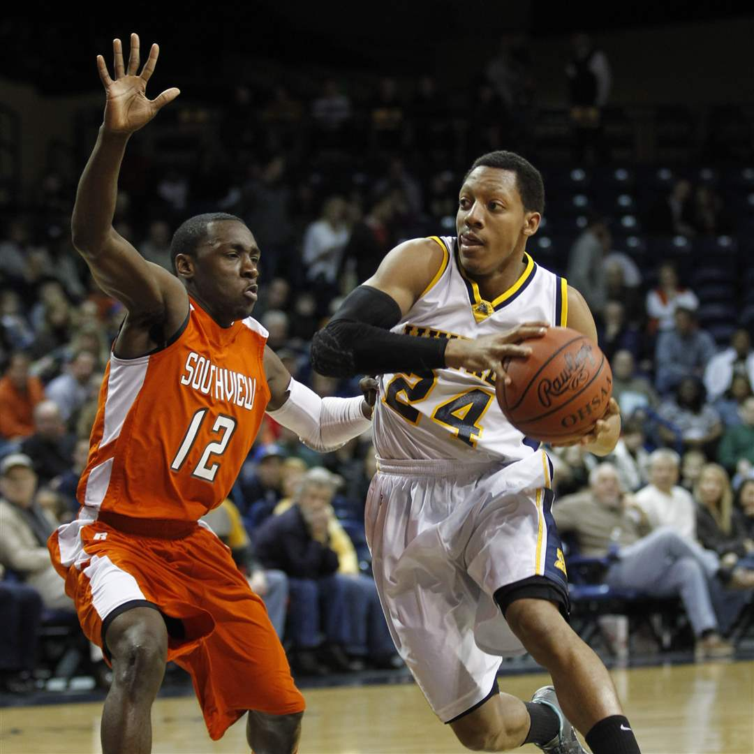 Whitmer-High-School-player-Leroy-Alexander-24-drives-past-Sylvania-Southview-player-Chris-Johnson