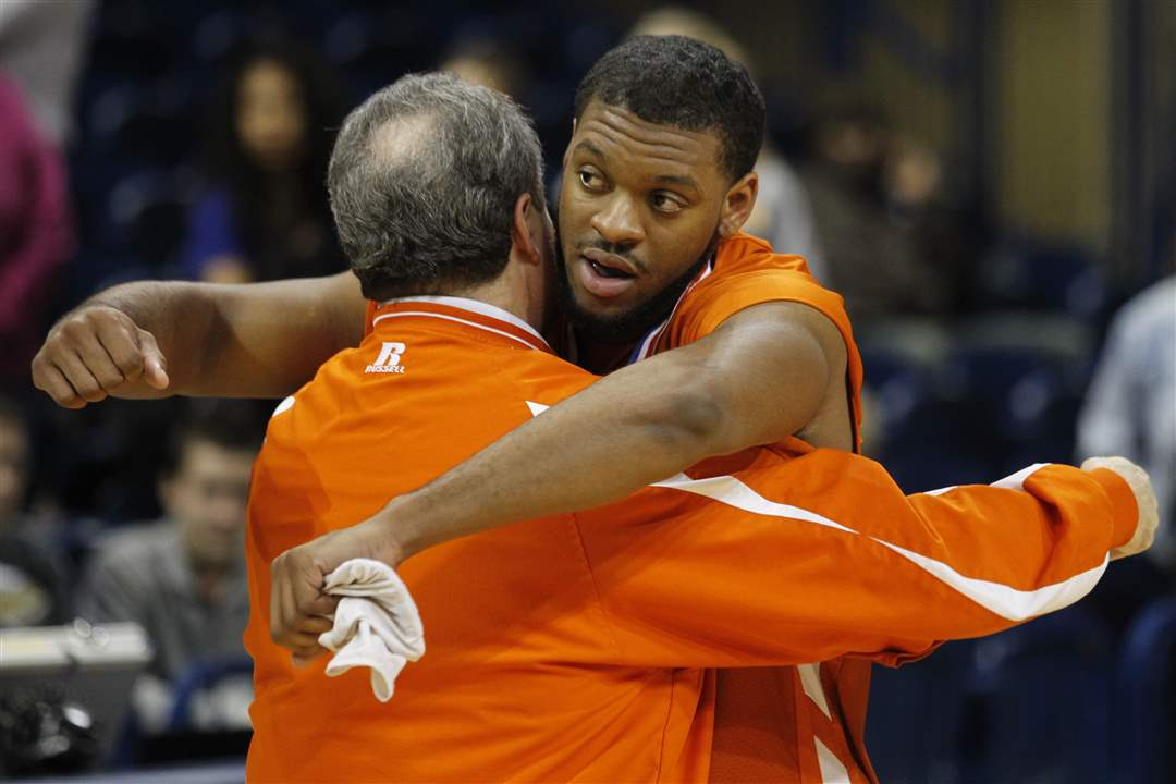 Sylvania-Southview-player-Allen-Gant-gets-a-hug-from-athletic-director-Glen-Gillespie