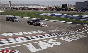 Tony Stewart races to victory in the Kobalt Tools 400 at Las Vegas Motor Speedway on Sunday.