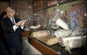 Scott Carroll leads a tour of items from the Green Collection on display at the Vatican.