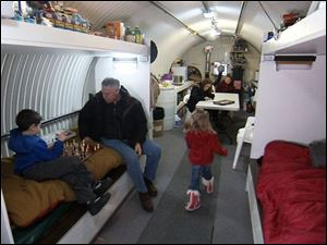 Peter Larson and his family relax in their underground bunker, which they use as a weekend getaway.
