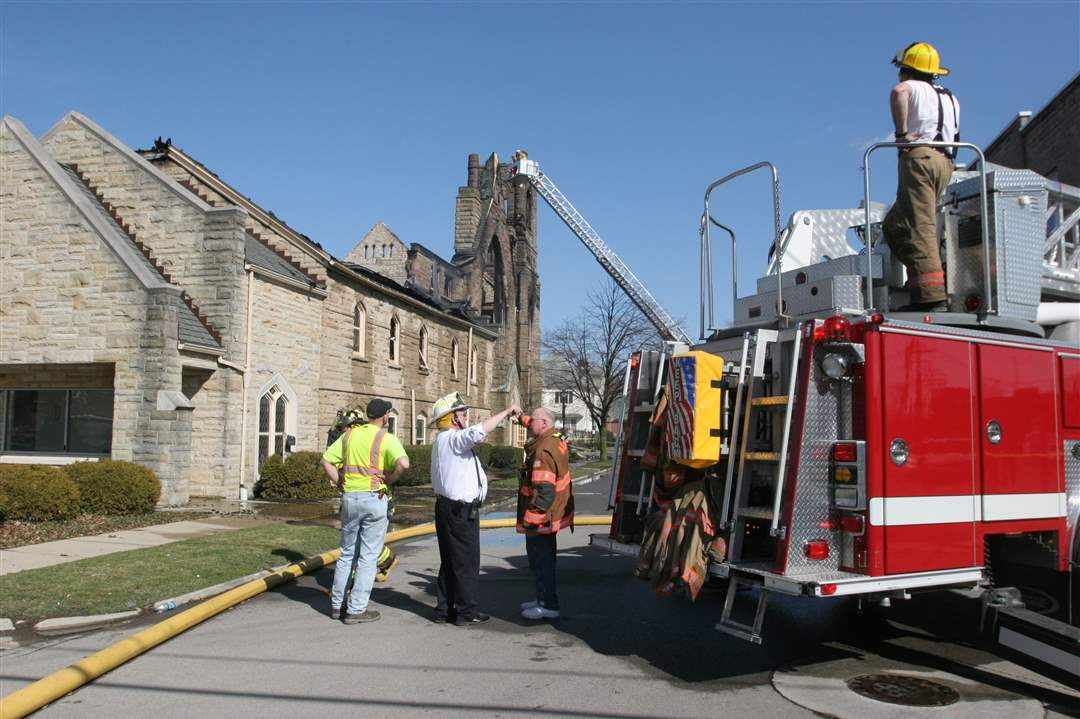 Firefighters-continue-to-battle-a-church-fire