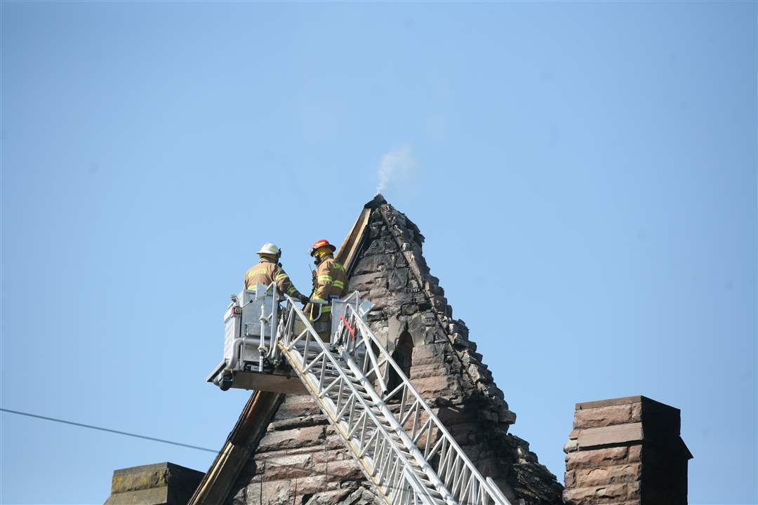 Firefighters-inspect-the-burned-out-church-in-Ada-OH