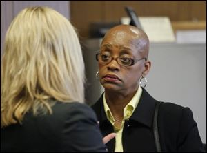 Gloria Burks confers with attorney Jane Roman, left, in Lucas County Common Pleas Court in Toledo, Wednesday, March 14, 2012. Burks is on trial for shooting fellow Sgt. Jeff Bechtel at the Scott Park police station.