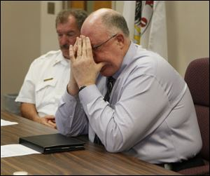 Wauseon Schools Superintendent Marc Robinson listens with Fire Chief Marvin Wheeler during a press conference regarding the shooting death of seventh grader Michael Schwartz, 13, who was shot in the chest and killed.