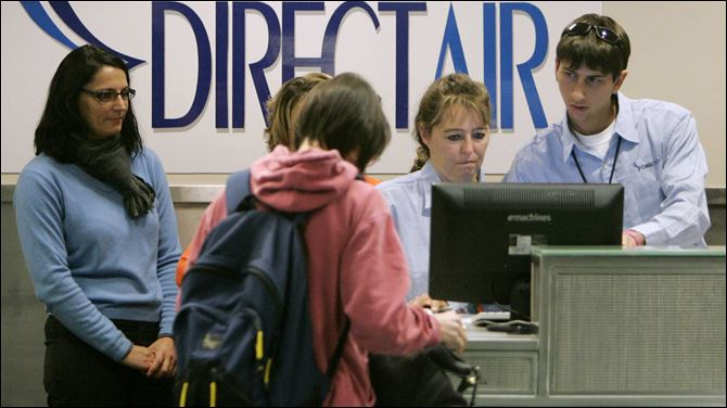 nationwide move affects toledo express DirectAir employees Sherry Andrews, second from right, and colleague Drew Schmalzreid, right, check passengers in for the first DirectAir flight from Toledo Express Airport in November, 2008. The airline said Tuesday it missed a payment to a fuel supplier and the firm cut it off.