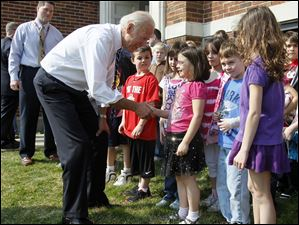 Vice-President Joe Biden visits students outside Glenwood School, in the Rossford School District, in Rossford, Ohio.