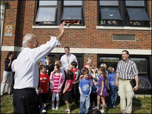 Biden waves to students and visitors at Glenwood School.