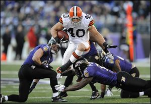 Cleveland Browns running back Peyton Hillis (40) leaps over Baltimore Ravens defenders in a December, 2011, game in Baltimore.