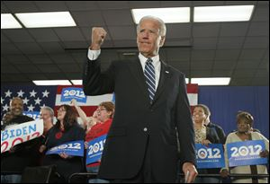 Vice President Joe Biden greets the crowd Thursday at the UAW Local 12 Hall in Toledo.