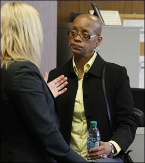 Sgt. Gloria Burks, right, speaks with her attorney, Jane Roman, in Common Pleas Court.
