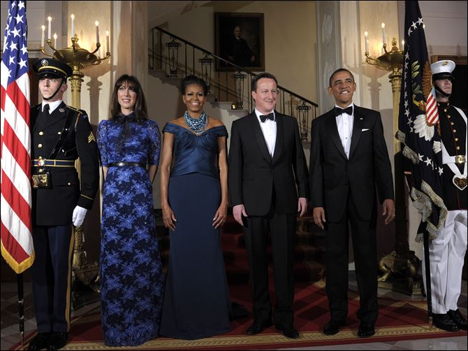 State dinner Obama Cameron President Barack Obama and first lady Michelle Obama pose for an official photo with British Prime Minister David Cameron and his wife, Samantha Cameron, at the White House before the state dinner.