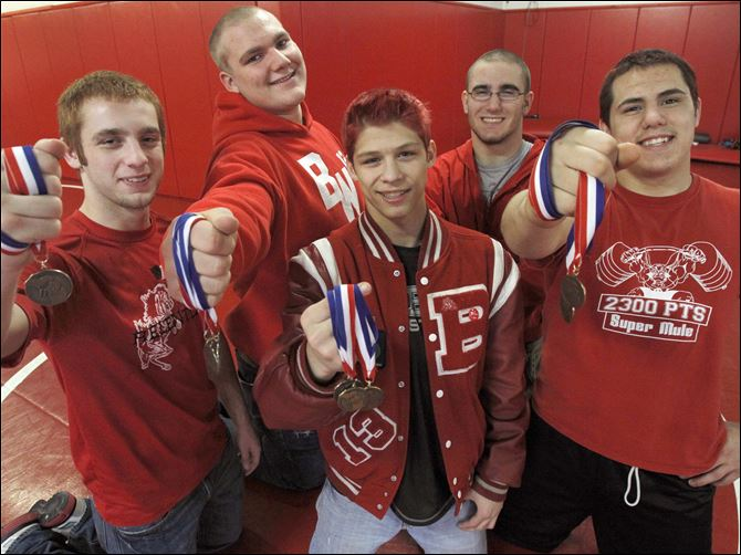 Twice as nice for Rogaliner Bedford wrestlers who competed at the state individual tournament were, from left, Al Regnier, Logan Rimmer, Mitchel Rogaliner, Brandon Sunday, and Bryan Smith. Rogaliner won the title at 112 pounds. He won the championship at 103 as a freshman and was runner-up at 103 last season. Rimmer and Sunday finished runners-up.