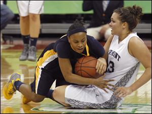 Notre Dame's Cat Wells steals the ball from Fairmont's Kathryn Westbeld.