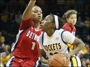 UDM's #1, Jalesa Jones tries to defend UT's Andola Dortch.