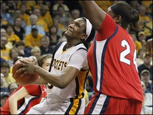 UT's Lecretia Smith tries to spin past UDM's #24 Shareta Brown.