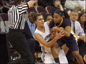 Notre Dame's Cat Wells, right, forces a jump ball with Fairmont's Kathryn Westbeld.