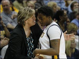 UT coach Tricia Cullop greets Brianna Jones as she comes back to the bench. It was Jones first time playing competitively since a concussion on February 28.