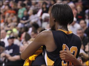 Notre Dame's Cat Wells, left, and Michelle Holmes hug after they both fouled out of the game.