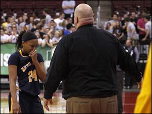 Notre Dame's Cat Wells cries as she returns to the bench after fouling out.