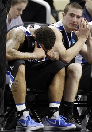 UNC-Asheville's J.P. Primm, left, and teammate Matt Dickey sit on the bench in the final seconds of a 72-65 loss to Syracuse.