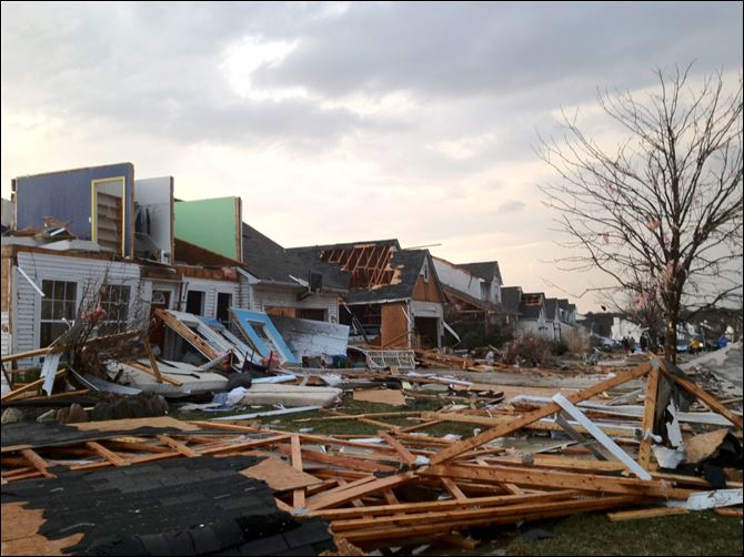 Slow-moving storm pounds S.E. Michigan Debris litters the streets in the Meadow View subdivision in Dexter, Mich. Emergency crews were assessing damage, but in one neighborhood, a home appeared to be flattened while adjacent homes were damaged.