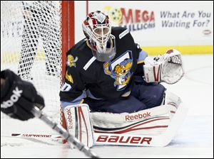Toledo Walleye goalie Carter Hutton, 30, keeps an eye on the action against the Cincinnati Cyclones during the second period, Friday, November 25, 2011.