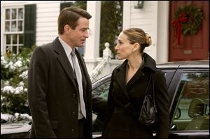 Everett Stone (Dermot Mulroney) tries to reassure his girlfriend Meredith Morton (Sarah Jessica Parker), who is nervous about meeting his family, in the film 'The Family Stone.'